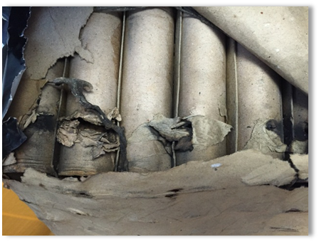 Image shows the ruptured cardboard tubes in a fan cake