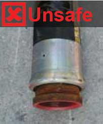 Image shows a metal fitting on the free end of the rubber delivery hose which is unsafe.