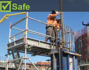 Image shows worker standing on a scaffold platform